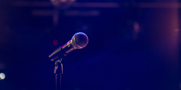 microphone on a  dark stage